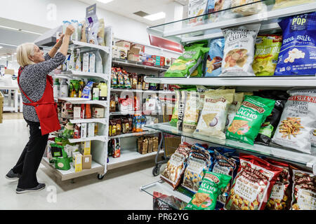 Miami Florida Kendall The Palms at Town & Country Mall Marshalls discount department store inside shopping display sale snack food bags chips senior w - Stock Photo