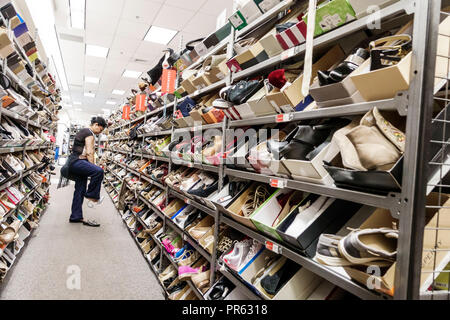 Miami Florida Kendall The Palms at Town & Country Mall Nordstrom Rack inside shopping display sale women's shoes shoe boxes Hispanic woman looking try - Stock Photo