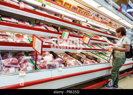 Miami Florida Little Havana Calle Ocho Sedano's supermarket grocery store food inside shopping display sale shelves meat meats Hispanic woman looking - Stock Photo