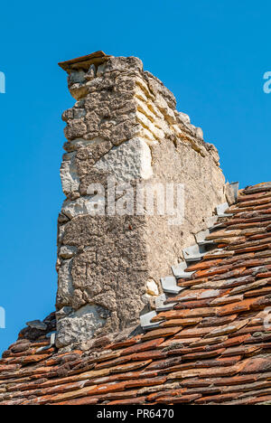 Old traditional domestic chimney stack in need of repair - France. - Stock Photo