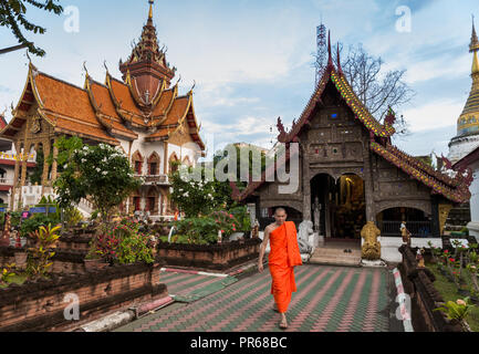 Monk at Wat Buppharam, an ancient Buddhist temple in Chiang Mai, Thailand. - Stock Photo