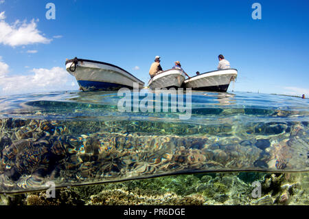 Boats close to shallow coral reef in the lagoon of Pohnpei, Federated States of Micronesia - Stock Photo