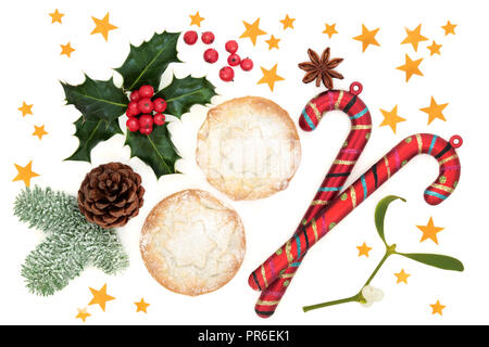Christmas festive symbols with mince pies, candy canes, winter flora of holly, mistletoe, snow covered fir and pine cone with gold stars on white. - Stock Photo