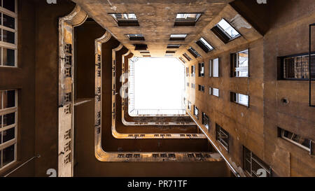 Upwards view in a dilapidated backyard in Budapest, Hungary - Stock Photo