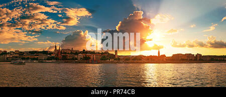 Sunset city skyline of Budapest. Matthias Church, Fisherman's Bastion and other historical buildings on Castle hill. View from Danube - Stock Photo