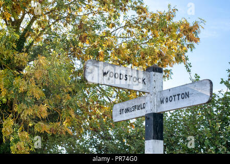 Woodstock town sign post in September. Oxfordshire, England - Stock Photo