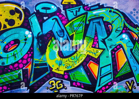 Detail of a colorful graffiti on a wall, abstract background - Stock Photo