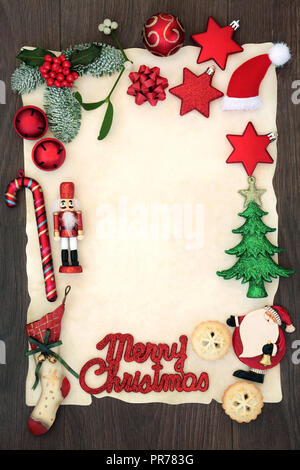 Blank letter to Santa Claus or party invitation with Merry Christmas sign on blank parchment paper with decorations, mince pies  and winter flora. - Stock Photo