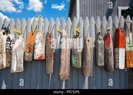 Lobster buoys hanging on a picket fence in Plymouth Harbor, Plymouth County, Massachusetts, USA - Stock Photo