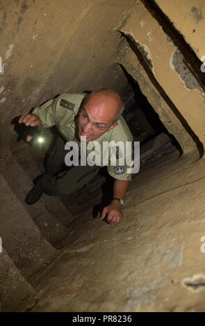 18 September 2018, Saxony-Anhalt, Colbitz: Holger Wille, head of the Lindenwald district, climbs the stairs to a former Soviet bunker on the Altmark military training area in the Letzlinger Heide near Colbitz. There is a bat quarter which was established as a compensatory measure for the construction of the A14 motorway. Photo: Klaus-Dietmar Gabbert/dpa-Zentralbild/dpa - Stock Photo