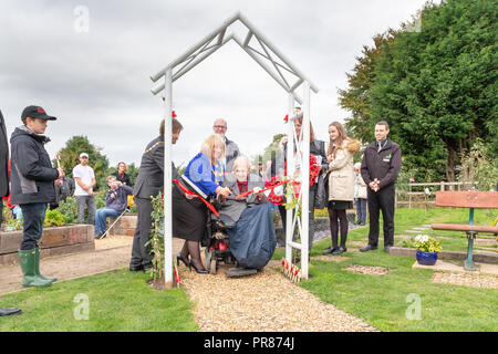 Cheshire, UK. 30 September 2018  The weather was cold and windy as The Mayor of Warrington, Cllr. Karen Mundry, opened the Memorial Garden and allotment with Commando Veteran Ken Preter. The land for the garden and allotment were donated to Shoulder to Soldier, the Leigh-based charity which dedicates it's time to supporting serving personnel, their families and veterans, by Bent's Garden & Home Centre in Glazebury, Cheshire Credit: John Hopkins/Alamy Live News - Stock Photo