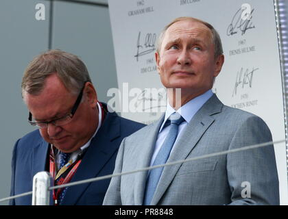 Sochi, Russia. 30th Sep, 2018. SOCHI, RUSSIA - SEPTEMBER 30, 2018: VTB Management Board President and Chairman Andrei Kostin (L) and Russia's President Vladimir Putin attend the 2018 Formula One Russian Grand Prix awarding ceremony at the Sochi Autodrom racing circuit. Sergei Fadeichev/TASS Credit: ITAR-TASS News Agency/Alamy Live News - Stock Photo