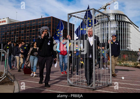 Birmingham, UK 30th September 2018. A jailed 'Boris Johnson' is paraded through the streets of Birmingham during an anti Brexit protest, locked up for crimes against human decency (C) Paul Swinney/Alamy Live News - Stock Photo