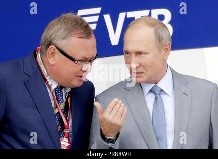 Sochi, Russia. 30th Sep, 2018. SOCHI, RUSSIA - SEPTEMBER 30, 2018: VTB Management Board President and Chairman Andrei Kostin (L) and Russia's President Vladimir Putin attend the 2018 Formula One Russian Grand Prix awarding ceremony at the Sochi Autodrom racing circuit. Mikhail Metzel/TASS Credit: ITAR-TASS News Agency/Alamy Live News - Stock Photo