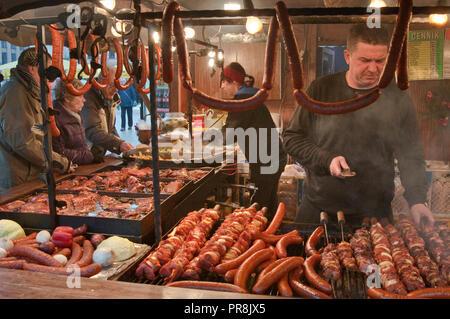 Hot sausages and shashlik or shish kebab at food stand at street fair in Christmas season on Main Market Square in Krakow, Poland