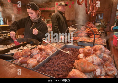 Hot pierogi and meat at food stand at street fair in Christmas season on Main Market Square in Krakow, Poland