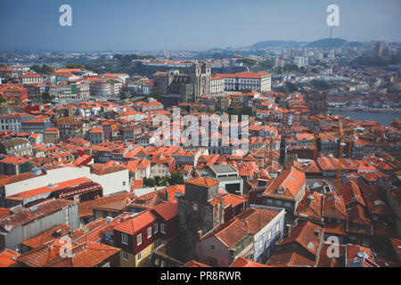 Beautiful super wide-angle summer aerial view of Porto, Norte Portugal region, Portugal, with skyline and scenery beyond the old town, shot from the o - Stock Photo