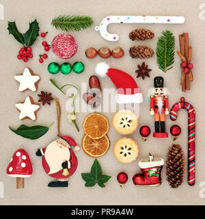 Traditional symbols of Christmas selection with food, old fashioned retro decorations and winter flora with berries, leaf sprigs and natural objects. - Stock Photo