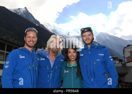 Sir Richard Branson with his son Sam Branson (left), nephew Noah Devereux (right) and founder of Tropic Skincare Susie Ma after completing their climb of Mont Blanc in the Alps to complete the Virgin Strive Challenge 2018, which saw the billionaire businessman Sir Richard Branson and his son come inches from death. - Stock Photo
