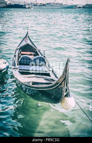 Historical gondola in harbor, Split, Croatia. Summer vacation. Travel destination. Analog photo filter with scratches. - Stock Photo