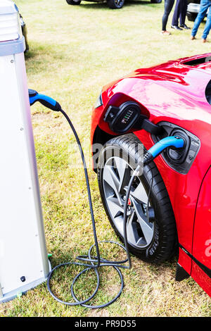 Electric car charging point, electric vehicle charging, car charging pod, Electric cars, plug-in hybrid, Electric cars charging, plug-in hybrids - Stock Photo