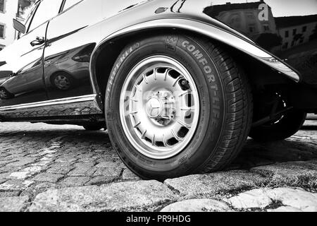 Mercedes Benz logo on vintage car wheel. Semperit logo on tyre. Mercedes-Benz is a German automobile manufacturer. The brand is used for luxury automobiles, buses, coaches and trucks. Black white image. - Stock Photo