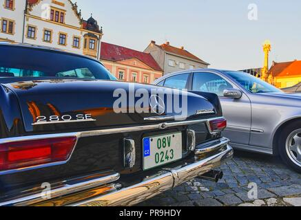 Mercedes Benz logo on a black vintage car. Mercedes-Benz is a German automobile manufacturer. The brand is used for luxury automobiles, buses, coaches and trucks.  - Stock Photo
