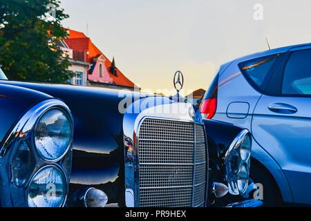 Mercedes Benz logo on a black vintage car.  Mercedes-Benz is a German automobile producer. The brand is used for luxury automobiles, buses, coaches and trucks.  - Stock Photo