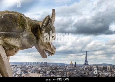 Gargoyle looking to Eiffel tower - Stock Photo