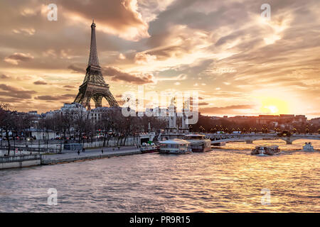 Amazing sunset in Paris, with Seine river, Pont Alexandre III and Eiffel tower - Stock Photo