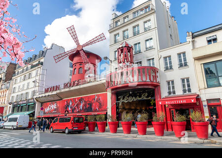 Moulin Rouge - famous cabaret built in 1889, in red-light district Pigalle on Boulevard de Clichy - Stock Photo