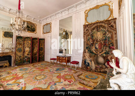 Versailles, France - March 14, 2018: Room inside of the Royal Palace of Versailles in France with visitors - Stock Photo