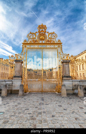 Main golden door in exterior facade of Versailles Palace, Paris, France - Stock Photo