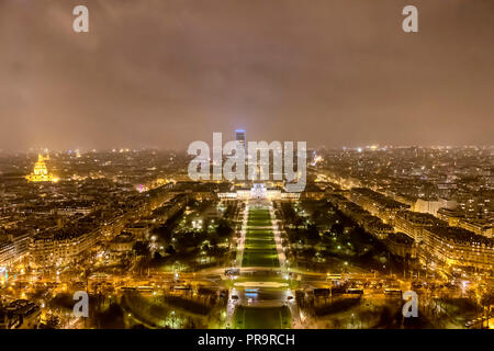 Aerial view on Champ de Mars (Mars fields) at night in a raining day - Stock Photo