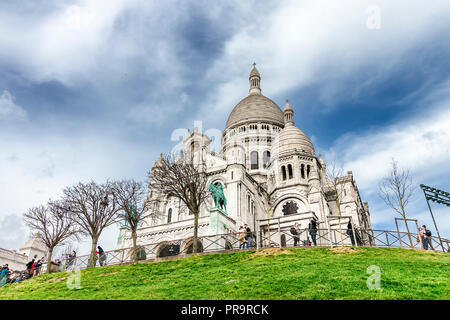 Paris, France - March 14, 2018: The Basilica of the Sacred Heart of Paris is a Roman Catholic church and minor basilica, dedicated to the Sacred Heart - Stock Photo