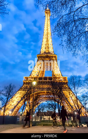 Paris, France - March 13, 2018: View of Eiffel tower illuminated at night - Stock Photo