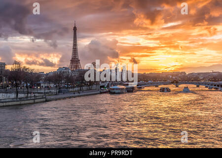 Amazing sunset in Paris, with Seine river and Eiffel tower - Stock Photo