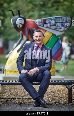 Carl Austin-Behan LGBT adviser to Andy Burnham Mayor of Manchester in  Sackville Gardens in Manchester's gay village, - Stock Photo