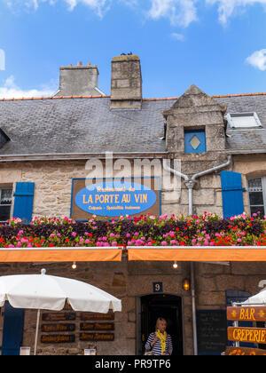 Brittany French old rustic alfresco restaurant 'La Port Au Vin' with floral flowers display  Ville Close de Concarneau Bretagne Finistere France - Stock Photo