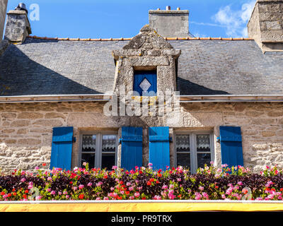 Brittany Architecture French Rustic restaurant 'La Port Au Vin' with floral display window shutters Ville Close Concarneau Bretagne Finistere France - Stock Photo