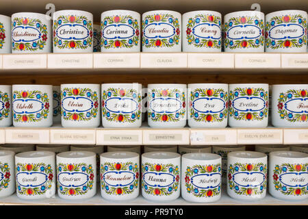 St. Gilgen, Austria - May 22, 2017: Personalized tea cups with female names on them for sale in a souvenir shop. - Stock Photo