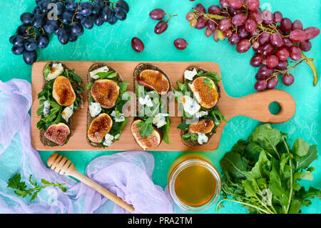 Useful sandwich with figs, blue cheese, arugula, balsamic on whole wheat bread. Healthy eating. - Stock Photo