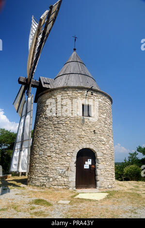 The windmill of St. Elzear de Montfuron on a hill outside the village of the same name the Alpes de Haute Provence in the south of France. - Stock Photo