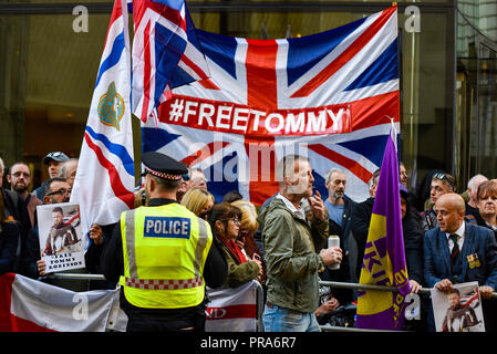 Protesters as Tommy Robinson AKA Stephen Yaxley Lennon appeared in Central Criminal Court (Old Bailey), London accused of contempt of court UKIP flag - Stock Photo