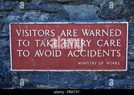 Ministry of Works warning sign: Visitors are warned to take every care to avoid accidents, Dolbadarn Castle, Llanberis, Gwynedd, North Wales, UK - Stock Photo