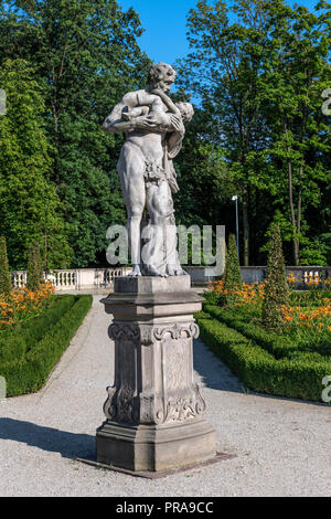 Warsaw, Poland - July 22, 2018: Royal garden of Wilanow Palace museum with statues and decorative trees. The Palace's museum, established in 1805, is  - Stock Photo