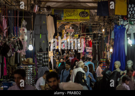 ISFAHAN, IRAN - AUGUST 20, 2018: Street of the Isfahan bazar in the evening, crowded and packed with people in the covered market. Symbol of the Persi - Stock Photo
