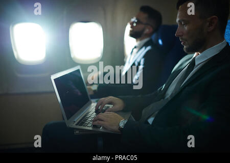 Business People in Plane - Stock Photo