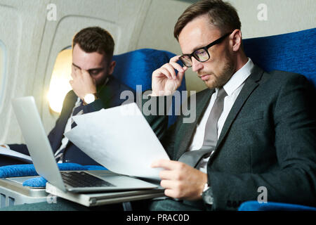 Business People Working in Airplane - Stock Photo