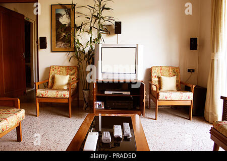 INTERIOR OF A HOUSE IN MUMBAI, INDIA SHOWING A TELEVISION AND HOME THEATRE SYSTEM - Stock Photo